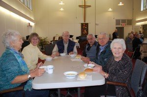 friends and neighbours enjoy a visit and delicious soup